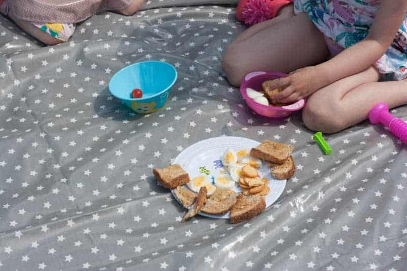 messy me oilcloth used as picnic rug